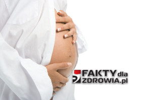 pregnant woman holding her belly